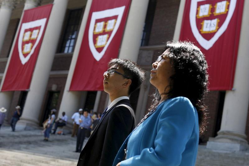 A student and parent pass Widener Library's banners before Harvard University's Class Day Exercises in Cambridge