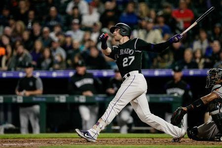 May 24, 2019; Denver, CO, USA; Colorado Rockies shortstop Trevor Story (27) watches his two run home run in the seventh inning against the Baltimore Orioles at Coors Field. Isaiah J. Downing-USA TODAY Sports