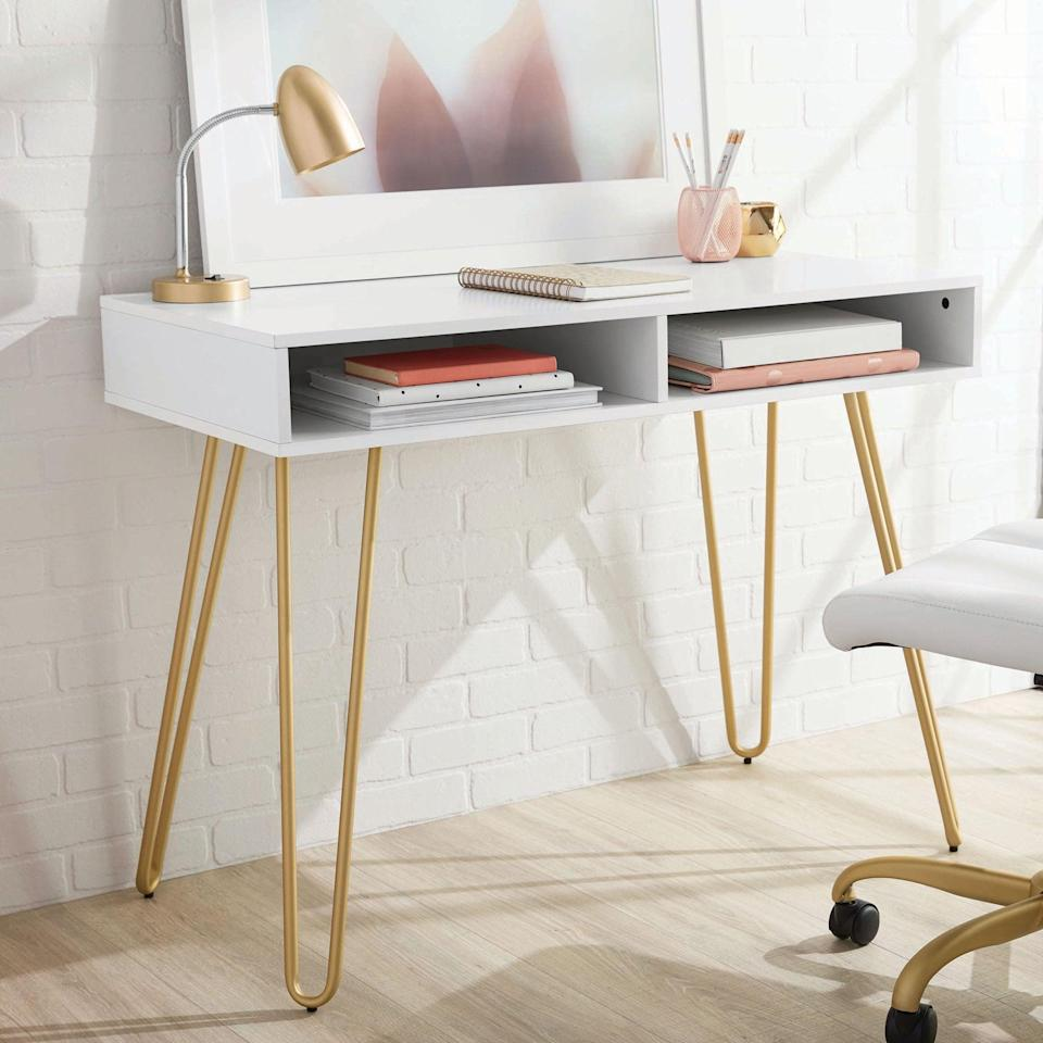 <p>Upgrade your desk with this stylish and fabulous <span>Mainstays Hairpin Writing Desk</span> ($89).</p>