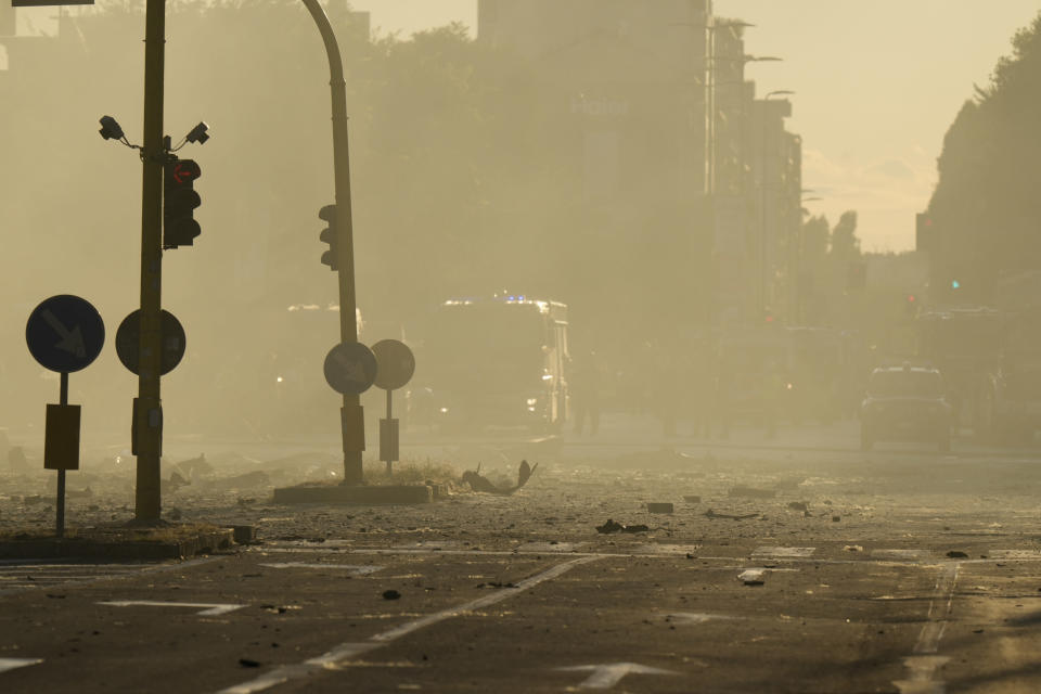 Debris lie on the ground after a building went on fire in Milan, Italy, Sunday, Aug. 29, 2021. (AP Photo/Luca Bruno)