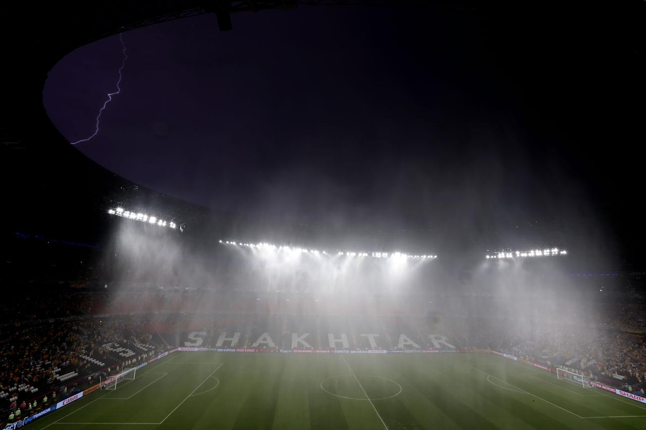 DONETSK, UKRAINE - JUNE 15: Play is suspended due to bad weather during the UEFA EURO 2012 group D match between Ukraine and France at Donbass Arena on June 15, 2012 in Donetsk, Ukraine.  (Photo by Julian Finney/Getty Images)