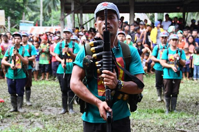 Members of the New People's Army in a remote village on Mindanao shown in this picture from December 26, 2014. The Philippine government and the communist rebels have agreed in principle on an interim ceasefire to boost ongoing peace talks (AFP Photo/STR)