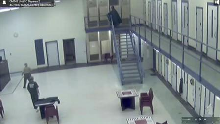 Jerome Hill climbs the stairs at the Chatham County Detention Center shortly before his suicide in Savannah