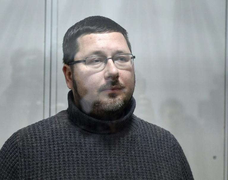 Stanislav Yezhov, a top government interpreter, stands in a glass cage at the start of his hearing on suspicion of being a Russian spy at the courthouse in Kiev on December 22, 2017    Ukrainian court selected two month in custody as a measure of restraint for Yezhov. Ukraine's SBU security service said it has detained an aide to the country's Prime Minister on suspicion of being a Russian spy