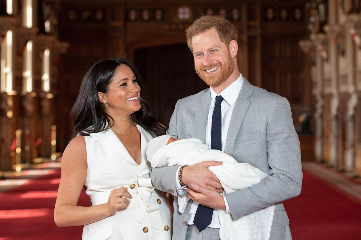 The Duke and Duchess of Sussex with their baby son, who was born on Monday morning, during a photocall in St George's Hall at Windsor Castle in Berkshire.