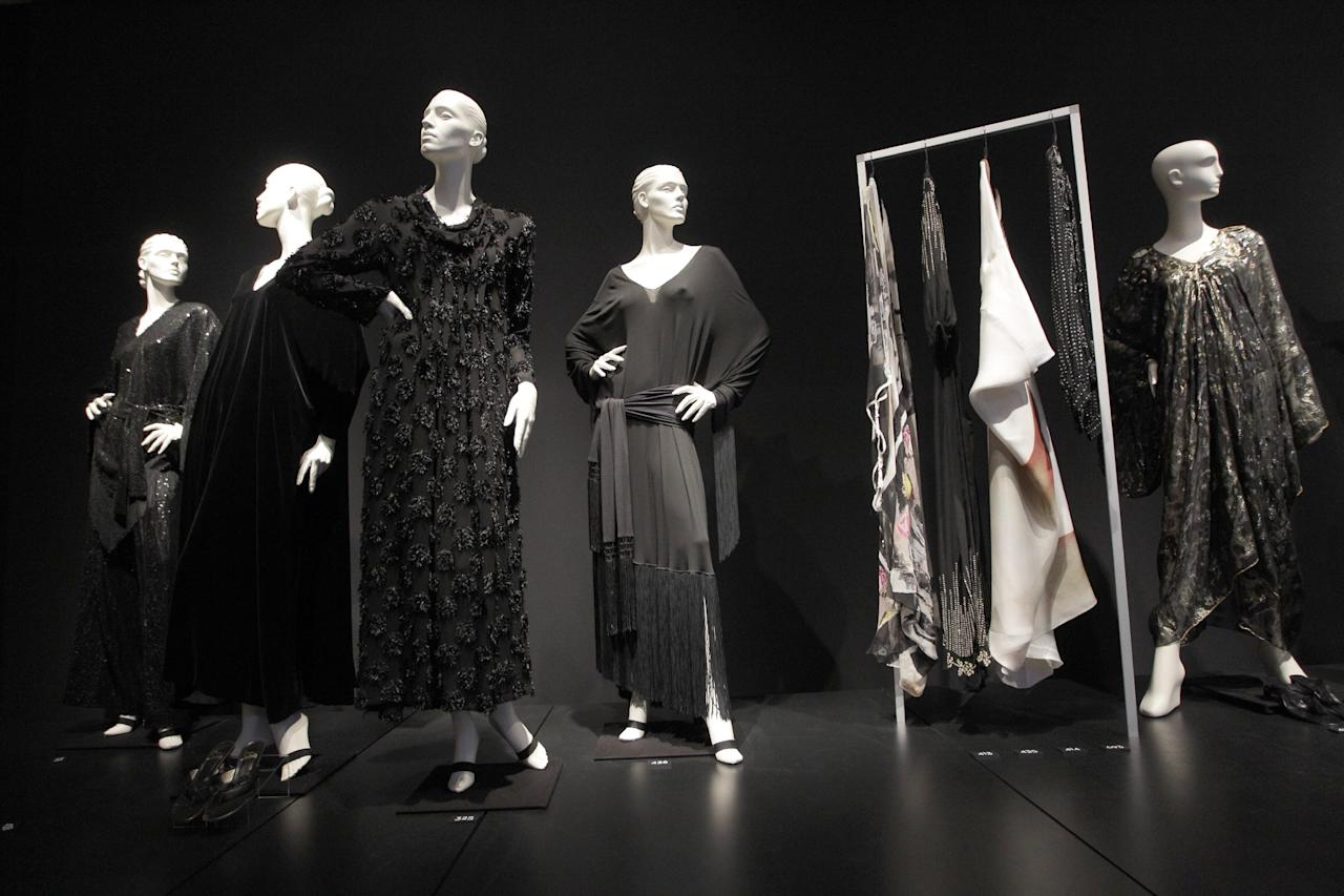 Dresses are on display during a preview of the full Collection of Elizabeth Taylor at Christie's, Thursday, Dec. 1, 2011 in New York. The collection will be up for auction in person and online, a first for Christie's, from Dec. 13-17. (AP Photo/Mary Altaffer)