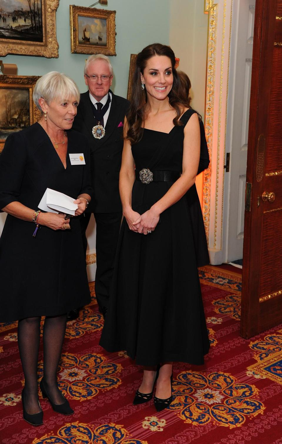 <p>Wearing a black version of the exact same red Preen dress she donned in Canada (worth £995), the Duchess showed off her toned arms at the Place2Be 2016 gala. Kate teamed the look with a statement belt and teased her hair into a half-updo. <i>[Photo: Getty]</i></p>
