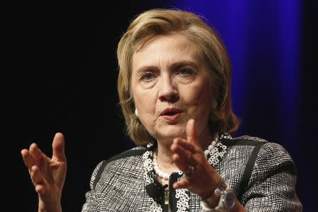 """Former U.S. Secretary of State Hillary Clinton reacts to a question as she discusses her new book """"Hard Choices: A Memoir"""" at George Washington University in Washington June 13, 2014. REUTERS/Jonathan Ernst"""