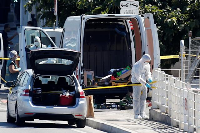 <p>French police conduct their investigation in the French port city of Marseille after one person was killed and another injured after a vehicle crashed into two bus shelters, in Marseille, France, Aug. 21, 2017. (Photo: Philippe Laurenson/Reuters) </p>