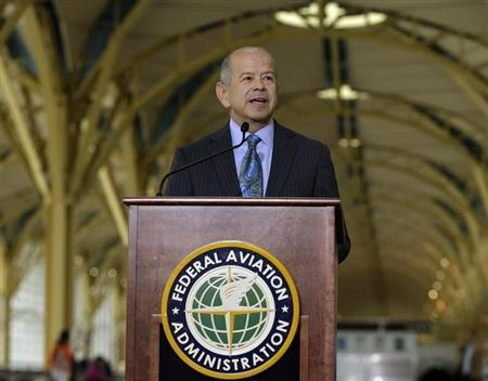 FAA Administrator Huerta holds news conference announcing expanded use of portable electronic devices at Reagan National Airport in Washington