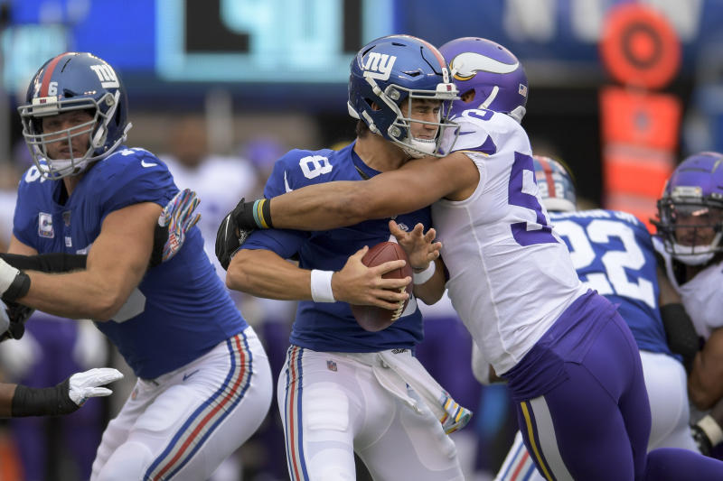 New York Giants quarterback Daniel Jones (8) is sacked by Minnesota Vikings outside linebacker Anthony Barr during the first quarter of an NFL football game, Sunday, Oct. 6, 2019, in East Rutherford, N.J. (AP Photo/Bill Kostroun)