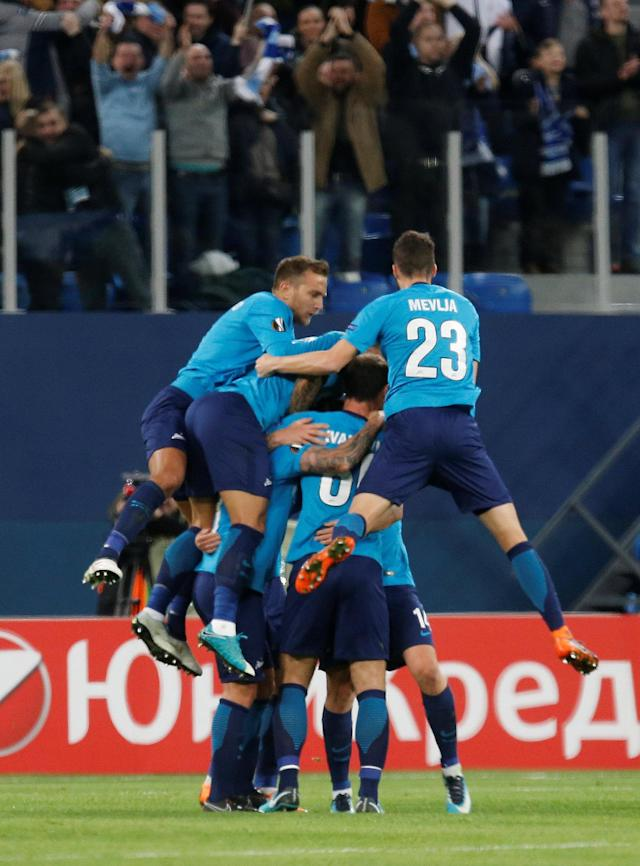 Soccer Football - Europa League Round of 32 Second Leg - Zenit Saint Petersburg vs Celtic - Stadium St. Petersburg, Saint Petersburg, Russia - February 22, 2018 Zenit St. Petersburg's Daler Kuzyayev celebrates with team mates after scoring their second goal REUTERS/Anton Vaganov