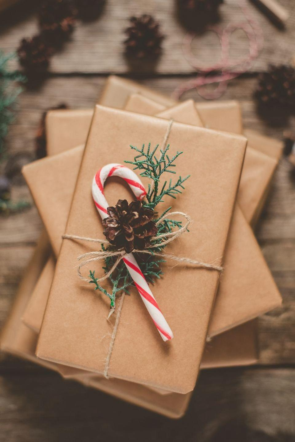 """<p>Another sweet holiday embellishment that'll take your gift wrapping up a notch? Candy canes, peppermints, or other wrapped seasonal candies. </p><p><a class=""""link rapid-noclick-resp"""" href=""""https://www.amazon.com/YumEarth-Organic-Holiday-Candy-Canes/dp/B07YMMK73J?tag=syn-yahoo-20&ascsubtag=%5Bartid%7C10072.g.34015639%5Bsrc%7Cyahoo-us"""" rel=""""nofollow noopener"""" target=""""_blank"""" data-ylk=""""slk:SHOP CANDY CANES"""">SHOP CANDY CANES</a></p>"""
