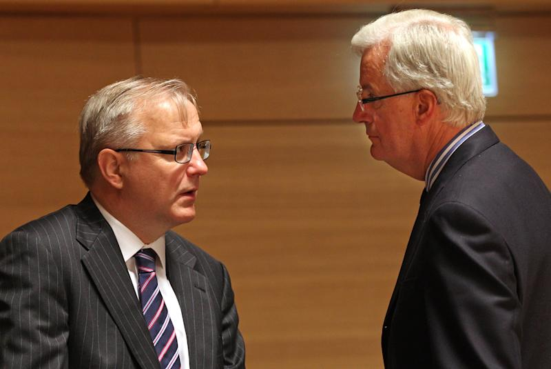 European Commissioner for Economic and Monetary Affairs Olli Rehn, left, talks with European Commissioner for Internal Market and Services Michel Barnier, at the EU finance ministers meeting, in Luxembourg, Tuesday Oct. 9, 2012. EU finance ministers assess the budgetary situation in Portugal and address the challenges of the European financial crisis. (AP Photo/Yves Logghe)