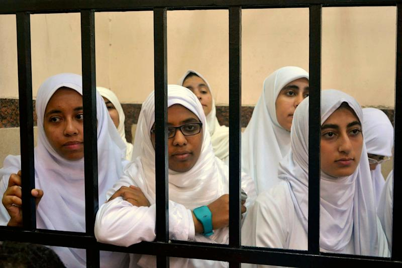 Egyptian women supporters of ousted President Mohammed Morsi stand inside the defendants' cage in a courtroom in Alexandria, Egypt, Wednesday, Nov. 27, 2013. An Egyptian court has handed down heavy sentences of 11 years in prison to 21 female supporters of the ousted Islamist president, many of them juveniles, for holding a protest. (AP Photo/Amira Mortada, El Shorouk Newspaper) EGYPT OUT