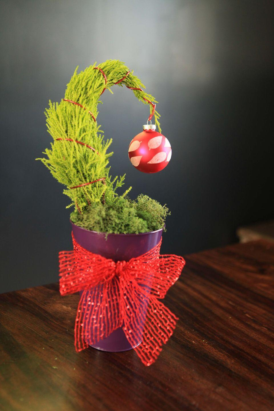 "<p>Stephanie Rose of Garden Therapy transforms a mini lemon cypress into a quirky Grinch-inspired tree. You don't have to have a green hand—a little green thumb will do! </p><p><strong>Get the tutorial at <a href=""https://gardentherapy.ca/table-top-grinch-tree/"" rel=""nofollow noopener"" target=""_blank"" data-ylk=""slk:Garden Therapy"" class=""link rapid-noclick-resp"">Garden Therapy</a>.</strong></p><p><strong><a class=""link rapid-noclick-resp"" href=""https://www.amazon.com/Metallic-Poly-Deco-Ribbon-Yards/dp/B00PKRBHPA/ref=sr_1_1?dchild=1&keywords=mesh+wired+ribbon+red&qid=1603062382&sr=8-1&tag=syn-yahoo-20&ascsubtag=%5Bartid%7C10050.g.28982778%5Bsrc%7Cyahoo-us"" rel=""nofollow noopener"" target=""_blank"" data-ylk=""slk:SHOP MESH RIBBON"">SHOP MESH RIBBON</a><br></strong></p>"