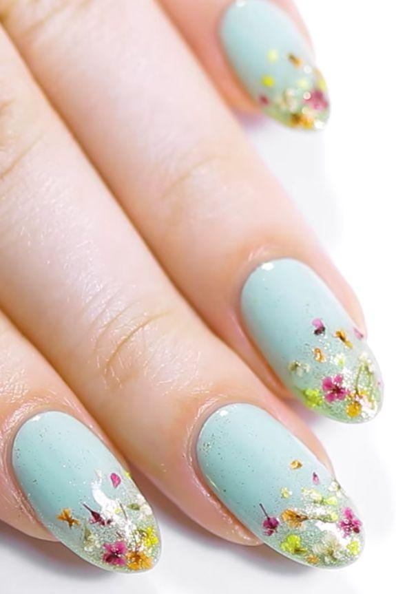 "<p>Instead of painting on flowers, why not apply actual petals? In this Ipsy manicure, nail artist Kristin Gardner attached tiny dried blooms to a glitter-ombre base.</p><p><a rel=""nofollow"" href=""https://www.amazon.com/Nail-Art-Real-Dried-Flower/dp/B008EJJ50A/ref=sr_1_16_a_it"">SHOP DRIED FLOWERS</a></p><p><em><a rel=""nofollow"" href=""https://www.youtube.com/watch?v=goOdS2MoajE"">See more on YouTube »</a> </em><br></p>"