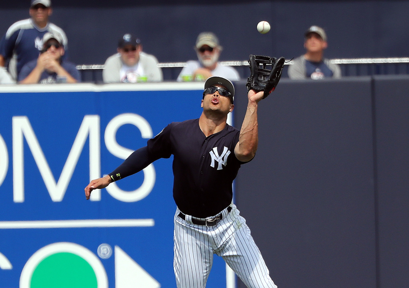 Stanton makes catch in OF spring training