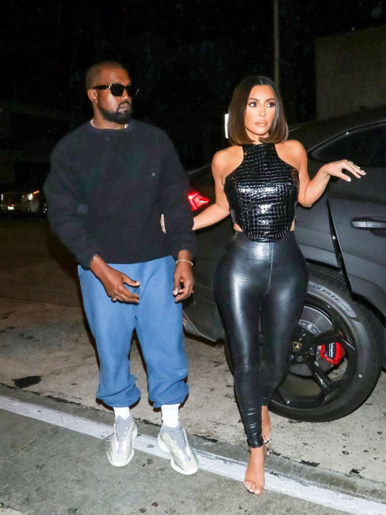 <p>Kanye, looking super cool in sunglasses, a sweatshirt and oversized bottoms, ventured out in the evening with Kim who looked like a leather-clad, bob-haired 90s dream.</p>