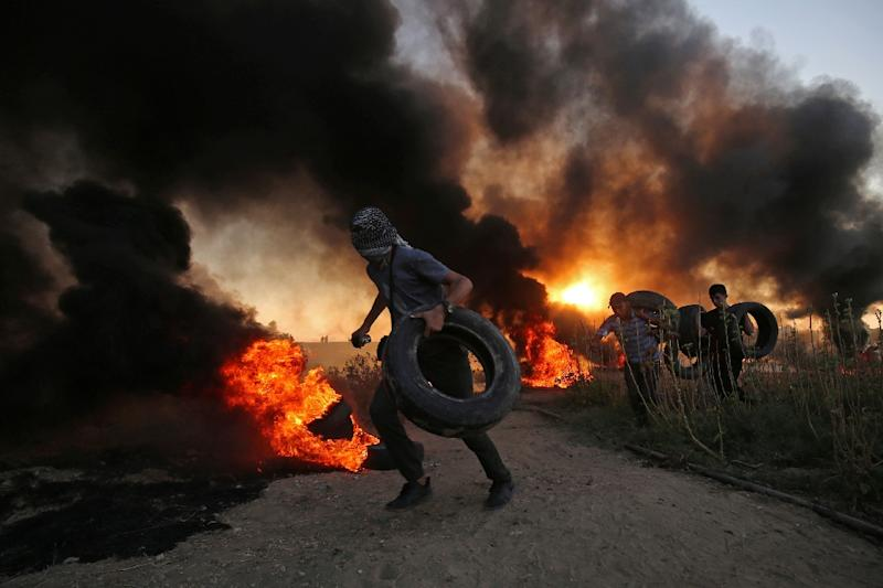 Palestinians burn tyres on the Gaza-Israel border on October 12, 2018 in one of the near-daily protests held since March 30 that have drawn a deadly response from the Israeli army and stoked fears of an escalation (AFP Photo/SAID KHATIB)