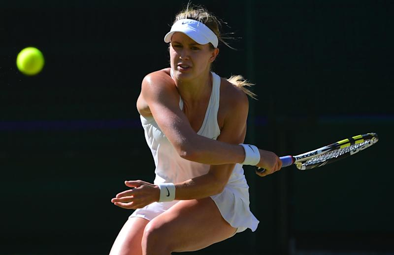 Eugenie Bouchard returns to Simona Halep during their women's singles semi-final match at The All England Tennis Club in Wimbledon, on July 3, 2014