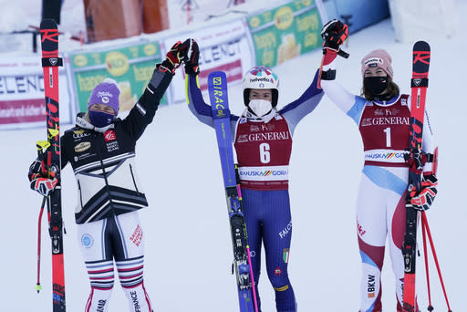 From left, second placed France's Tessa Worley, the winner Italy's Marta Bassino, and third placed Switzerland's Michelle Gisin, pose in the finish area after an alpine ski, women's World Cup giant slalom, in Kranjska Gora, Slovenia, Saturday, Jan. 16, 2021. (AP Photo/Giovanni Auletta)