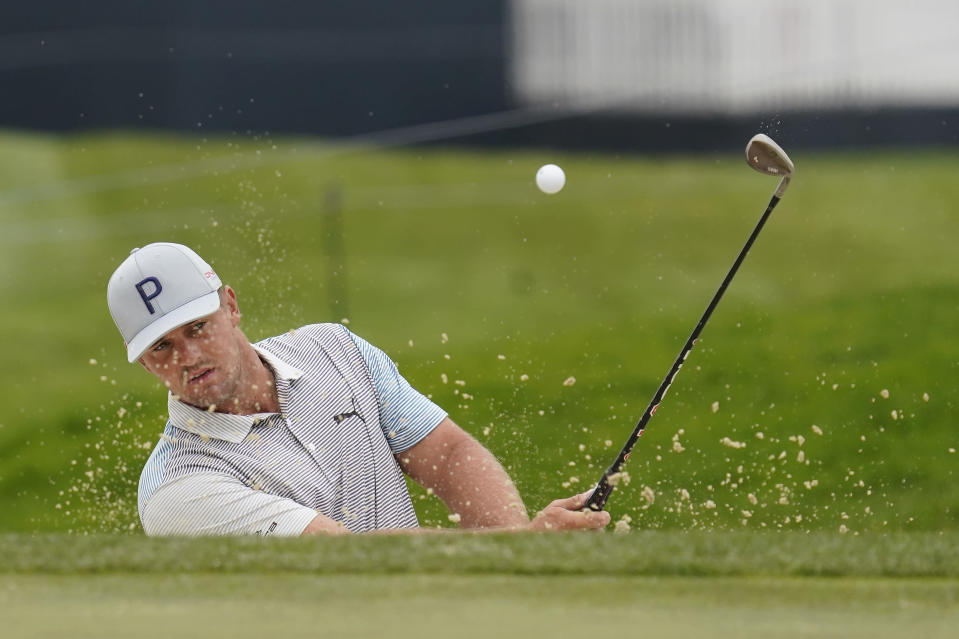 Bryson DeChambeau hits from a bunker to the first green during practice for the PGA Championship golf tournament at TPC Harding Park in San Francisco, Tuesday, Aug. 4, 2020. (AP Photo/Jeff Chiu)