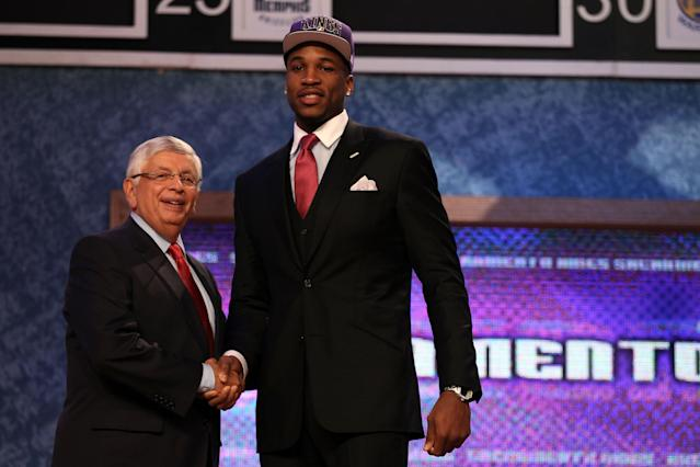 NEWARK, NJ - JUNE 28: Thomas Robinson (R) of the Kansas Jayhawks greets NBA Commissioner David Stern (L) after he was selected number five overall by the Sacramento Kings during the first round of the 2012 NBA Draft at Prudential Center on June 28, 2012 in Newark, New Jersey. NOTE TO USER: User expressly acknowledges and agrees that, by downloading and/or using this Photograph, user is consenting to the terms and conditions of the Getty Images License Agreement. (Photo by Elsa/Getty Images)