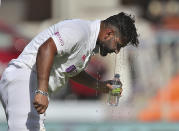 India's Rishabh Pant pours cold water on his head to beat the heat drinks water during the second day of fourth cricket test match between India and England at Narendra Modi Stadium in Ahmedabad, India, Friday, March 5, 2021. (AP Photo/Aijaz Rahi)