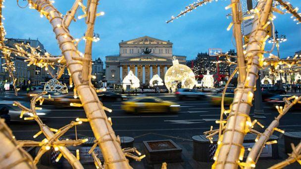 PHOTO: Cars pass the Bolshoi Theatre amid holiday decorations in Moscow, Dec. 21, 2020. (Pavel Golovkin/AP)