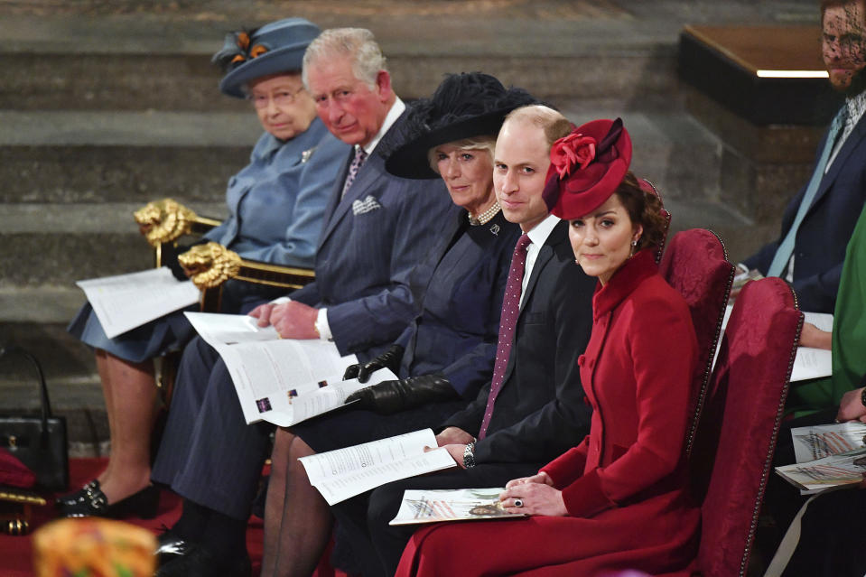 FILE - In this file photo dated Monday March 9, 2020, members of Britain's royal family, Queen Elizabeth II, Prince Charles, Camilla, Duchess of Cornwall, Prince William and Kate, Duchess of Cambridge attend the annual Commonwealth Service at Westminster Abbey in London.  The prince's Clarence House office reported on Wednesday, March 25, 2020 that the 71-year-old Prince Charles is showing mild symptoms of COVID-19 and is self-isolating at a royal estate in Scotland, also saying his wife Camilla has tested negative. (Phil Harris/Pool via AP)
