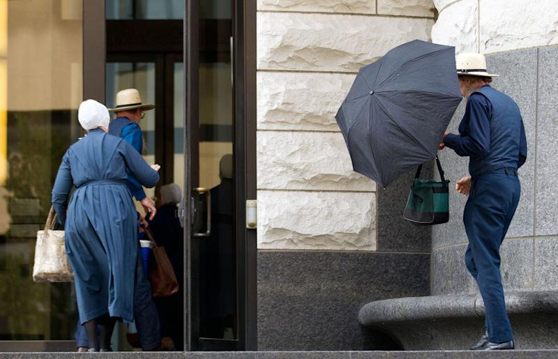 Amish enter the U.S. Federal Courthouse in Cleveland on Thursday, Sept. 20, 2012. The jury will begin their fifth day of deliberations in the trial of 16 Amish people accused of hate crimes in hair- and beard-cutting attacks against fellow Amish in Ohio. (AP Photo/Scott R. Galvin)