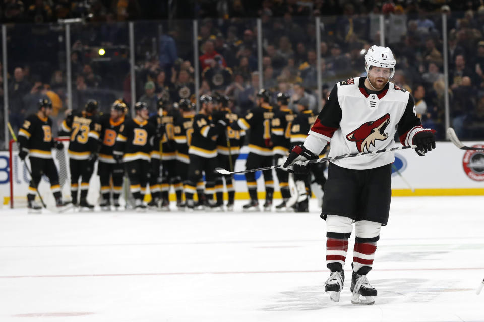 Arizona Coyotes' Phil Kessel skates to the locker room as the Boston Bruins congratulate each other after their win in an NHL hockey game Saturday, Feb. 8, 2020, in Boston. (AP Photo/Winslow Townson)