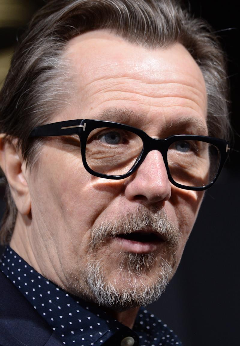 "Actor Gary Oldman arrives for the Los Angeles premiere of ""Robocop"" at TCL Chinese Theatre in Hollywood, California on February 10, 2014"