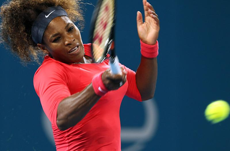Serena Williams of the United States plays a shot during her quarterfinal match against her compatriot Sloane Stephens at the Brisbane International tennis tournament held in Brisbane, Australia, Thursday, Jan. 3, 2013. (AP Photo/Tertius Pickard)