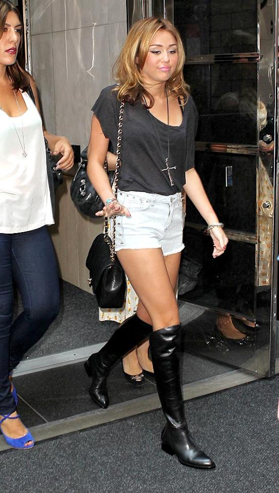 """Speaking of stars we haven't seen in quite some time, Miley Cyrus -- who's been busy shooting her new film in Michigan -- reappeared in Manhattan the other day in daisy dukes, knee-high boots, an oversized cross, and a sour face full of pancake makeup. <a href=""""http://www.infdaily.com"""" target=""""new"""">INFDaily.com</a> - August 31, 2010"""