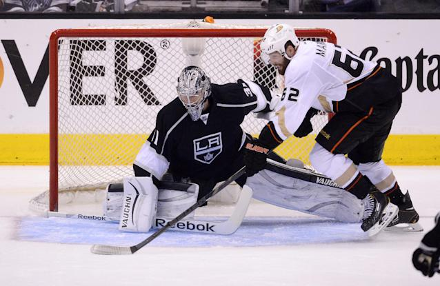 Anaheim Ducks left wing Patrick Maroon, right, tries to get a shot in on Los Angeles Kings goalie Martin Jones during the third period in Game 4 of an NHL hockey second-round Stanley Cup playoff series, Saturday, May 10, 2014, in Los Angeles. The Duck won 2-0. (AP Photo/Mark J. Terrill)