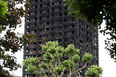 FILE PHOTO: Damage to Grenfell Tower is seen following the catastrophic fire, in north Kensington, London, Britain, June 25, 2017.  REUTERS/Peter Nicholls/File Photo