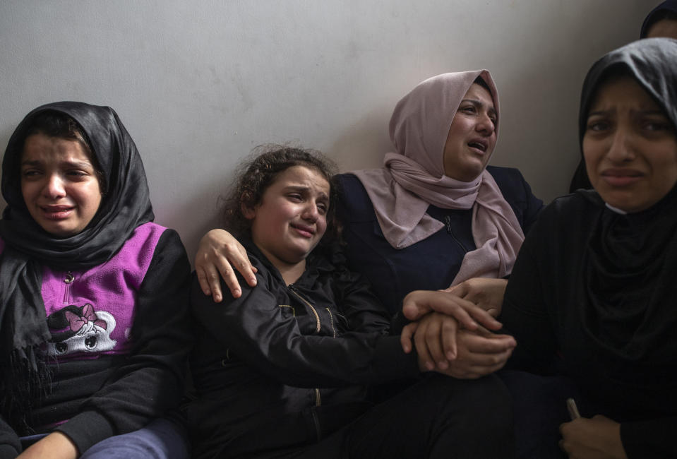 Relatives of Islamic Jihad commander, Bahaa Abu el-Atta, who was killed with his wife by an Israeli missile strike that hit their home, mourn during the funeral in Gaza City, Tuesday, Nov. 12, 2019. (AP Photo/Khalil Hamra)