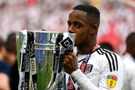 Soccer Football - Championship Play-Off Final - Fulham vs Aston Villa - Wembley Stadium, London, Britain - May 26, 2018 Fulham's Ryan Sessegnon celebrates promotion to the Premier League with the trophy Action Images via Reuters/Carl Recine