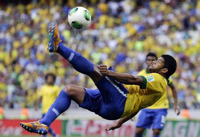 FILE - In this June 19, 2013, file photo, Brazil's Hulk kicks the ball during the soccer Confederations Cup group A match between Brazil and Mexico at Castelao stadium in Fortaleza, Brazil. Hulk is part of the backbone of a squad that is expected to win the World Cup. (AP Photo/Natacha Pisarenko, File)