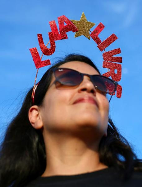 """A Lula supporter wears a headband reading """"Free Lula"""" during a demo outside the Supreme Court in Brasilia"""