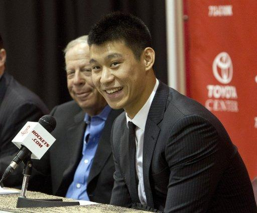Jeremy Lin of the Houston Rockets speaks to the media as he is introduced during a press conference at Toyota Center, on July 19, in Houston, Texas. Lin has signed a three year $25 mln contract with the Rockets