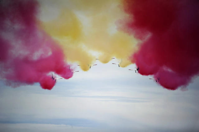 <p>The Patrulla Aguila (Eagle Patrol), the Spanish Air Force's acrobatic demonstration team, performs during the Spanish Red Bull Moto3 Grand Prix at the Jerez de la Frontera racetrack, May 7, 2017. (Cristina Quicler/AFP/Getty Images) </p>