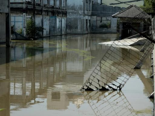 Shops are submerged in northern Jakarta in July 2019