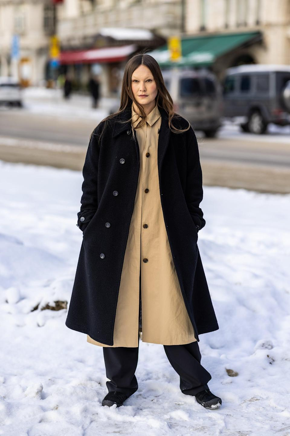 <p>Wear one thicker, open coat over another of a slightly different length, fabric, and color.</p>