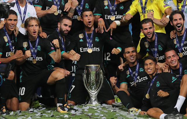 Soccer Football - Real Madrid v Manchester United - Super Cup Final - Skopje, Macedonia - August 8, 2017 Real Madrid's Cristiano Ronaldo and teammates celebrate winning the super cup final with the trophy REUTERS/Eddie Keogh TPX IMAGES OF THE DAY