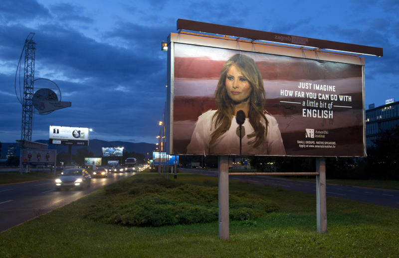 Cars drive past a billboard depicting the first lady Melania Trump and advertising a language school displayed in Zagreb, Croatia, Friday, Sept. 15, 2017. (AP Photo/Darko Bandic)