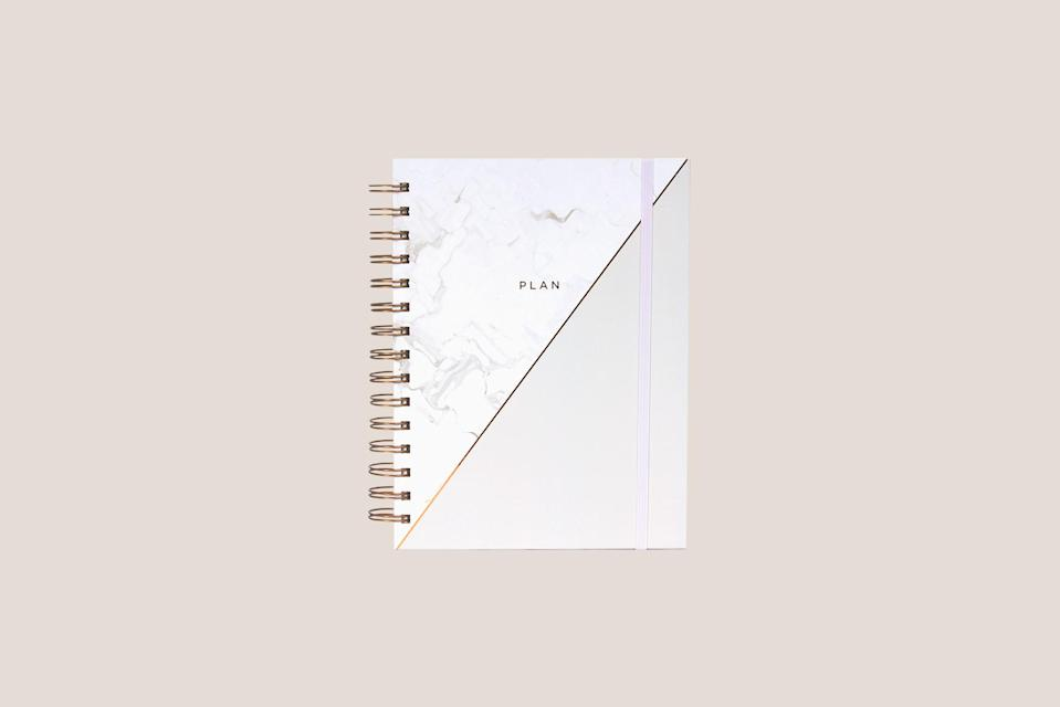 """<p>For those that love a marble motif, this spiral bound school planner is the perfect way to stay ahead of schedule. It's undated and features monthly and weekly spreads.</p> <p><strong><em>Shop Now:</em></strong><em> Hadron Epoch Spiral Planner in Grey Pearl, $26, <a href=""""https://www.hadronepoch.com/collections/planners/products/spiral-planner-grey-pearl"""" rel=""""nofollow noopener"""" target=""""_blank"""" data-ylk=""""slk:hadronepoch.com"""" class=""""link rapid-noclick-resp"""">hadronepoch.com</a>.</em></p>"""