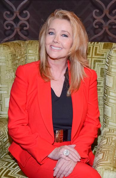 """Melody Thomas Scott poses for a photo at """"The Young and the Restless"""" 41st Anniversary, on Tuesday, March 25, 2014, in Los Angeles. (Photo by Tonya Wise/Invision/AP)"""